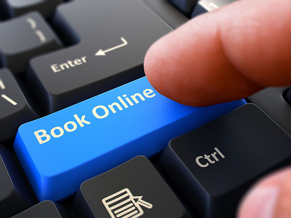 A visual of a customer pressing a Book Online button for Studio Bookings