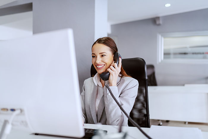 Business lady answering customer as a representation of Telephony