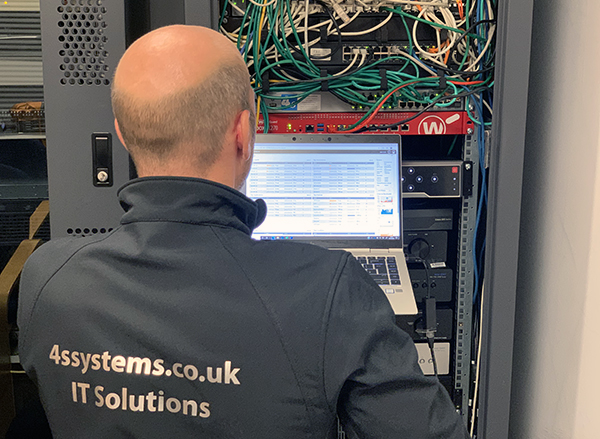 Our IT Engineer working on a server at a client in London